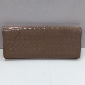 GUCCI clutch patent leather